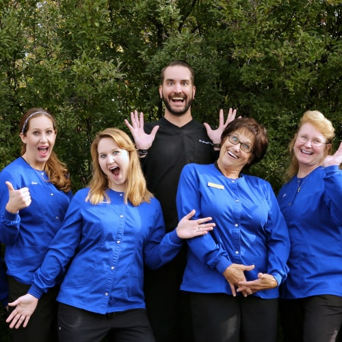 Funny shot of our Fox Valley Dental staff holding funny mouths