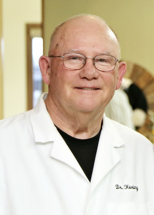 Dr. Hering is wearing his white coat as one of our doctors in Fox Valley
