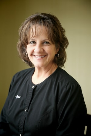 Lynn is part of our front desk team and is seen here smiling