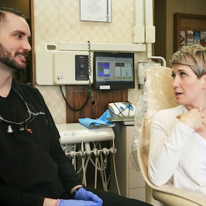 Dr. Olsen talking to a female patient what their new patients exam