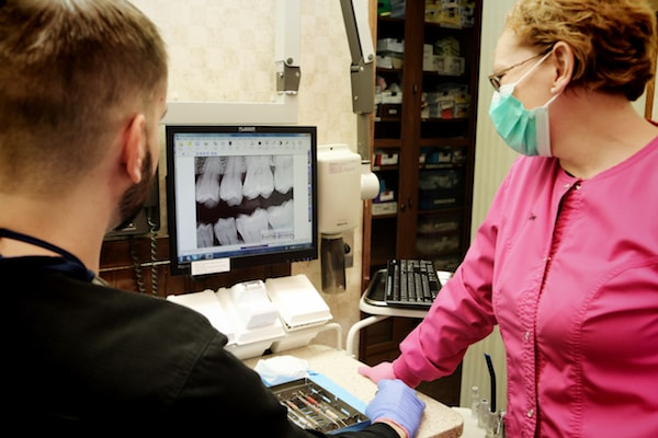 Our team members consulting a digital x-ray to determine the best course of dental care in Fox Valley