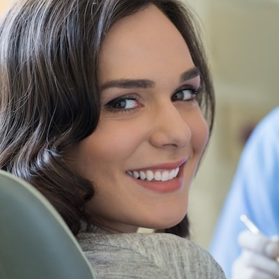 A female porcelain veneers patient before her cosmetic dentistry procedure