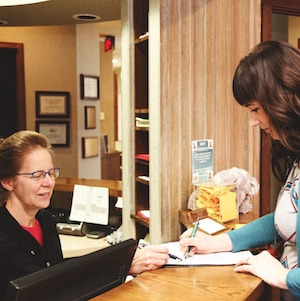 Mary greeting one of our new patients at the front desk