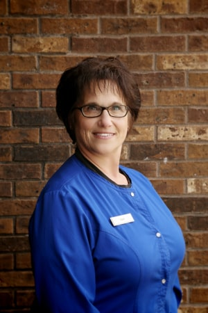 Barb smiling, as part of our dental assistant team