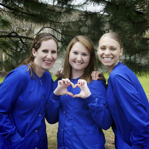 Fox Valley Dental staff smiling and making a heart